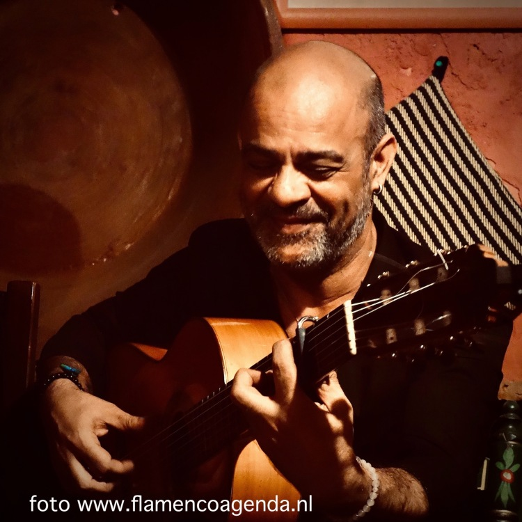 Live flamenco guitar during performance at Flamenco Esencia in Triana Sevilla.