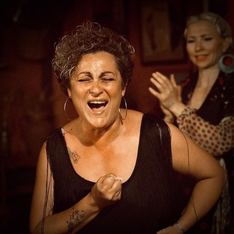 Inspired moment during flamenco performance in Seville, Spain.